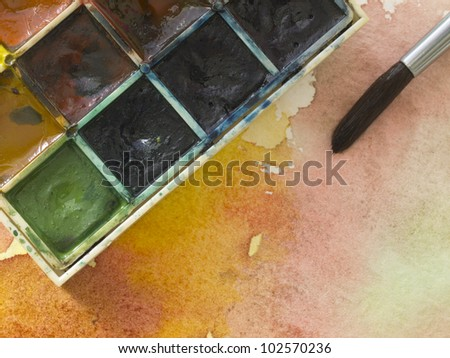 painting material on the watercolor background - stock photo