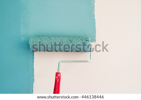 Painting of walls in a blue color. Repair in a house.