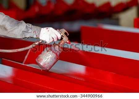 Painting process by spray gun for decoration work piece - stock photo