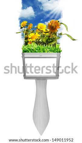 painting sun flower with brushes  - stock photo