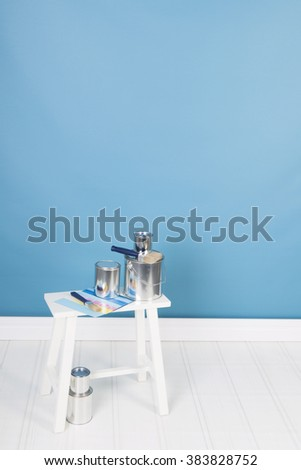 Painting the interior with tins and brushes - stock photo