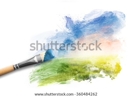 Painting the spring landscape. Brush with blue paint over sky and green field. Concept of creating art, creativity, imagination. - stock photo