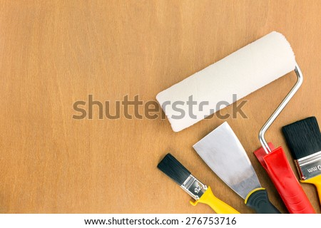 painting tools and accessories for home renovation on wooden background - stock photo