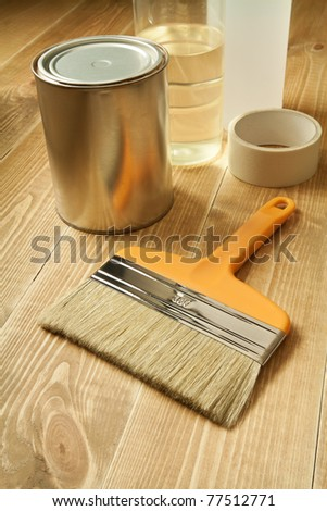 Painting tools on wooden floor. - stock photo