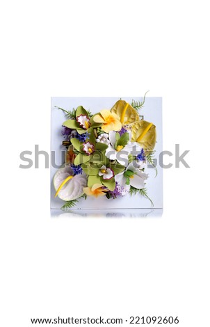 painting with flowers on isolated background with reflection - stock photo