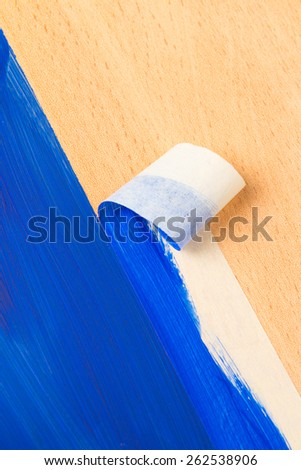 Painting with masking tape also known as sticky tapy - stock photo