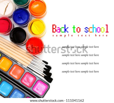 Paints and brushes on a white background. Back to school. - stock photo