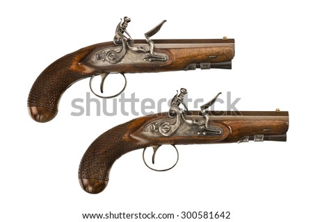 Pair flintlock pistols old vintage antique short barreled isolated on white