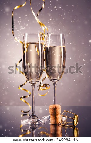 Pair glass of champagne. New Year celebration theme with blur spots of bubbles - stock photo