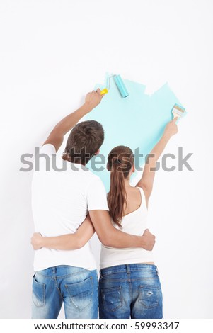 Pair had paint the walls green - stock photo