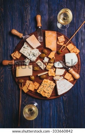 Pair have a nice evening with cheese plate and wine - stock photo
