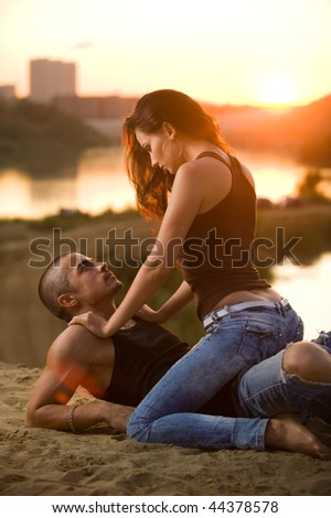 Pair in jeans on a sunset - stock photo