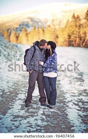 pair kissing on mountains - stock photo