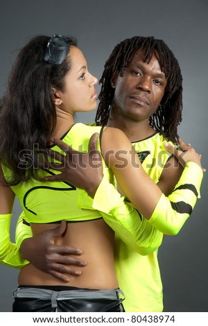 Pair lad and girl in bright dance suit in studio