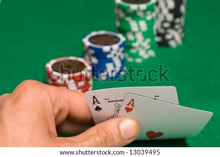 Pair of ace in winners hand - stock photo