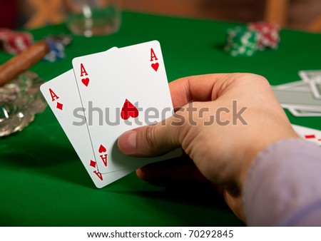 Pair of aces in his hand poker player.