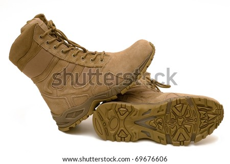 Pair of army boots, a protector on a sole - stock photo
