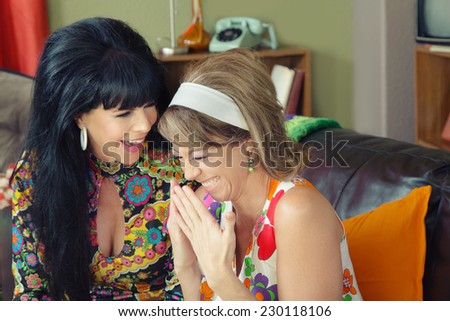 Pair of beautiful European giggling 1960s women - stock photo