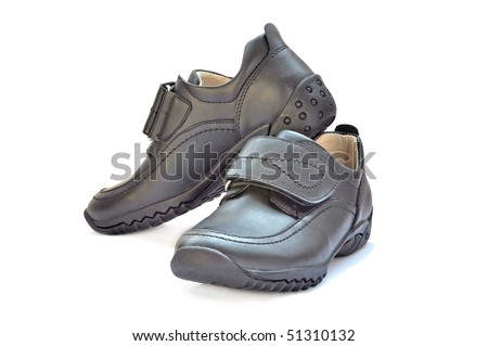 Pair of black children shoes on white background - isolated