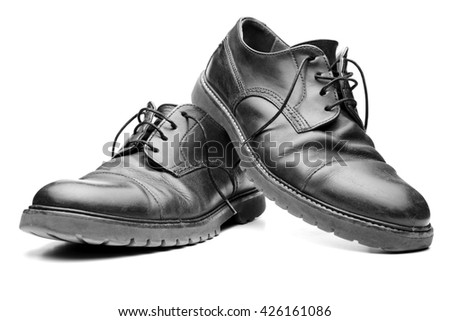 pair of black leather shoes isolated