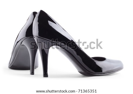 Pair of black patent leather female high-heeled shoes isolated on white background - stock photo