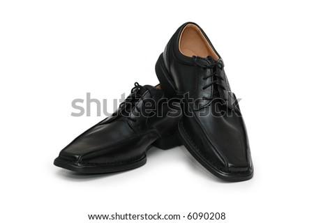 Pair of black shoes isolated on white - more similar photos in my portfolio - stock photo