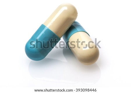Pair of Blue pills capsule isolated on white background - stock photo