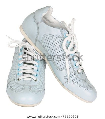 Pair of blue trainers, isolated on a white background - stock photo