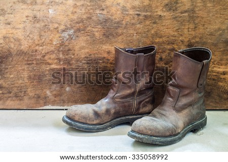 Pair of brown leather shoes  with wooden background