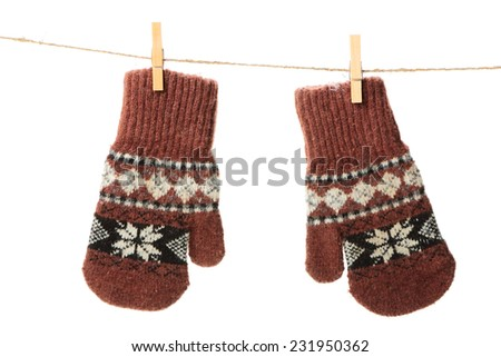 Pair of brown mitten with ethnic ornament isolated on white background - stock photo