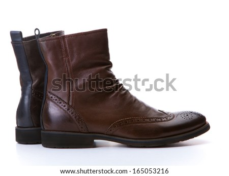 Pair of brown stylish boots isolated on white - stock photo
