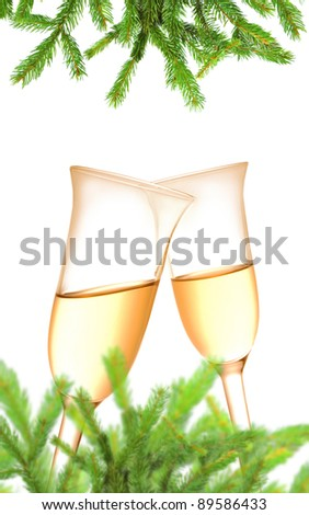 Pair of champagne flutes and Christmas decoration on white background - stock photo