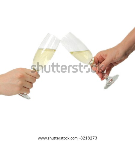 Pair of champagne flutes making a toast - stock photo
