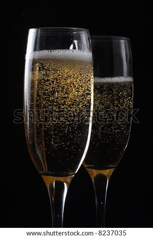 Pair of champagne flutes with dark background