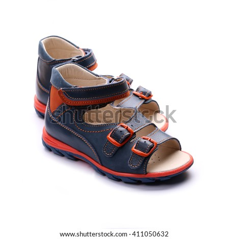 Pair of children's shoes. Isolated on white background. - stock photo