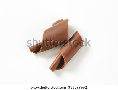 pair of chocolate shavings on white background - stock photo