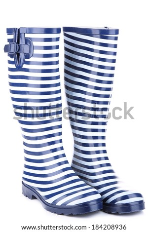 Pair of colorful gumboots isolated on white - stock photo