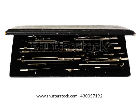 Pair of Compasses and Other Drawing Instruments on White - stock photo