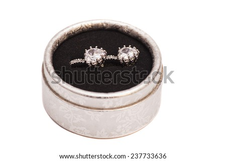 Pair of diamond crystal earrings in  silver box - stock photo