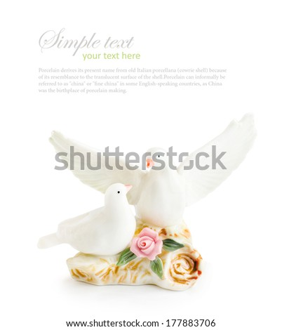 pair of dove figurine isolated on a white background  - stock photo