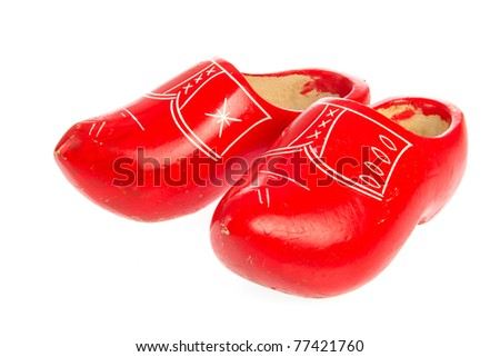 Pair of Dutch red wooden clogs isolated over white