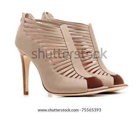 Pair of female beige shoes over white background - stock photo