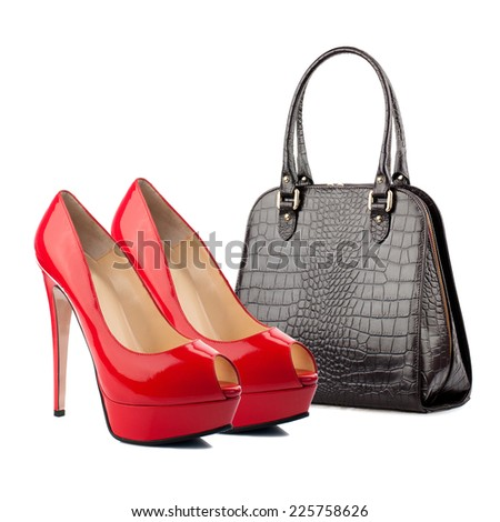 Pair of female shoes and handbag isolated on white.  - stock photo