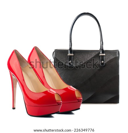 Pair of female shoes and handbag isolated on white.