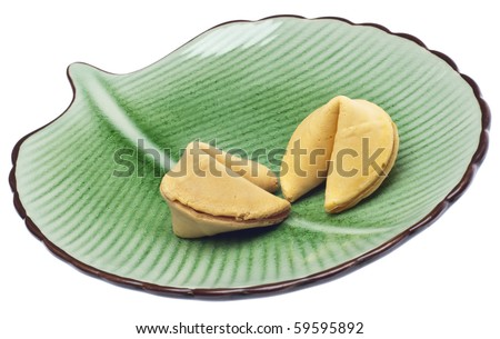 Pair of Fortune Cookies on a Green Plate Isolated on White with a Clipping Path. - stock photo