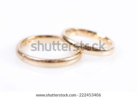 Pair of golden rings isolated on white background - stock photo