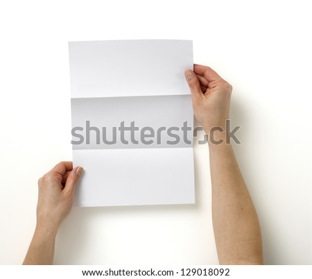pair of hands holding folded blank A4 copy space  letter with clipping path - stock photo