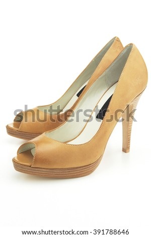 Pair of high heel sandals on white background - stock photo