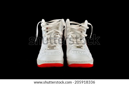 Pair of high-top classic white leather basketball shoes sneakers with isolated on black