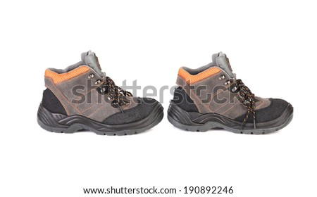 Pair of hiking boots. Isolated on a white background. - stock photo